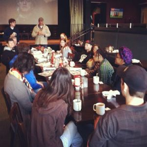 Restaurant owner and artist Andy Shallal speaks at Busboys and Poets-Hyattsville Book Club