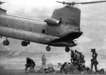 Chinook loads troops, mail, mermite cans, beer