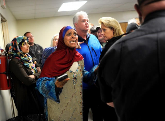 Sister Munira Salim Abdalla, chief administrator for the Islamic Center of Fredericksburg, asks a law enforcement official to intervene during a heated public meeting last year about a new mosque. (Peter Cihelka/ The Free Lance-Star )